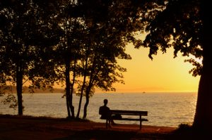 Calm person sitting on bench after temperament therapy